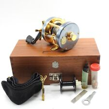 Blue and Gold Abu Ambassadeur 5500C Fishing Reel. W/ Wooden Box.