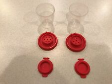 TUPPERWARE 1 SET OF NEW MINI SALT AND PEPPER SHAKERS IN CLEAR BASE/RED SEAL