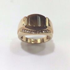 14 k yellow gold 9.6 grams  Diamond ring Tiger Eye Center Stone Made in the USA