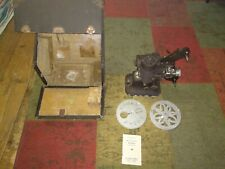 FILMO PROJECTOR. BELL AND HOWELL. DESING 57. MODEL JJ