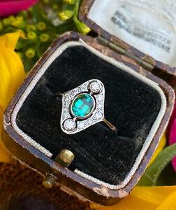 Art Deco Emerald and Diamond Platinum Ring 0.30ct + 0.60ct