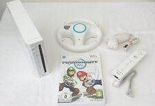 NINTENDO WII CONSOLE INCLUDING MARIO KART AND WII WHEEL.