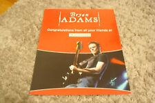 Bryan Adams congrat ad for receiving Hollywood Walk of Fame Star, playing guitar