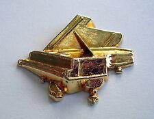 Fève dorée PIANO à QUEUE, dimensions: 32 x 27 mm.