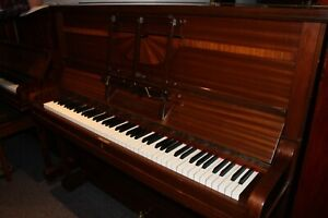 Hertman traditional style upright piano with attractive Art Deco casework