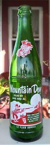 Mt. Dew, 12oz acl soda bottle. Filled by Jake and Al. 1965