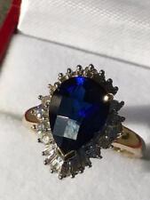 Blue 4.29ct Pear Shaped Sapphire & Baguette Round Brilliant Diamonds Ring