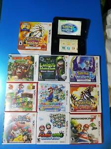 Nintendo 3DS with games Mario Luigi Pokemon Sun Moon console