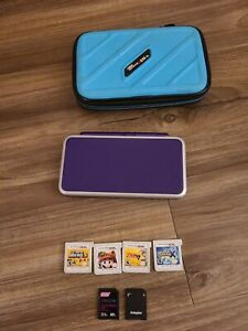 New Nintendo 2DS XL (Purple/Silver) w/4 games & carrying case TESTED & WORKING!