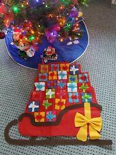 Filz - AdventskalenderSchlitten mit Geschenken zum Befüllen / 70 cm.