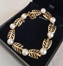 A modern 14ct gold naturalistic leaf design bracelet. Set with cultured pearls