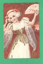 VINTAGE TUCK CHROMO ART POSTCARD FASHIONABLE GIRL FLOWERS IN HER HAIR FAN
