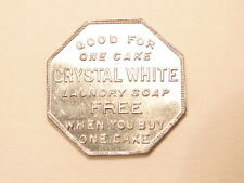 Octagonal aluminum  token: free Crystal White Laundry soap/ Palmolive-Peet Co.