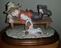 Gullivers World by Giuseppe Armani Figurine (Boy on Bench W/ Dog)