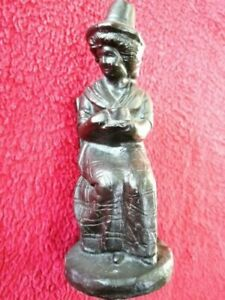Coal figurine of a Welsh Lady in traditional costume holding a beaker