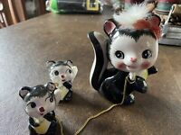 Vintage Ceramic Skunk figurine with babies on chain black white Japan