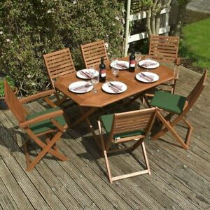 Plumley Six Seater Dining Hardwood Garden Set with Green Cushions Brown