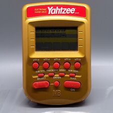 2002, Electronic Hand-Held Yahtzee Game, Turns on, Please see description.
