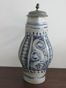 Antique Westerwald stoneware jug with stylized floral motif around 1820.