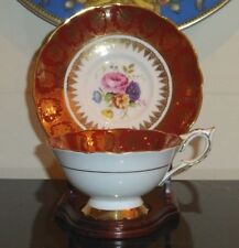 ROYAL STAFFORD DEEP RED GOLD TEA CUP AND SAUCER NUMBERED 4419 PLUS WOOD STAND