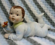 VINTAGE BISQUE PORCELAIN PIANO BABY BOY WITH PACIFIER FIGURINE