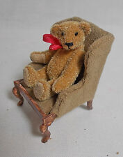 Dollhouse Miniature Antique Style Bear in aged velvet seat.