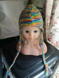 Ladies Knitted Hat. Multicoloured with plaits