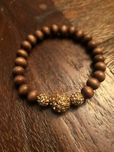 Stella and Dot Prosper bracelet gold and wood beads **new without tags**