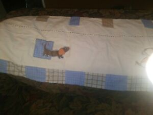 """Carter's blue Doggies Valance, blue and brown 60 X 14"""".  Rod holders on front"""