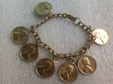 7 LINCOLN 1959 / 1959-D PENNY'S CHARM BRACELET 6 INCHES LONG
