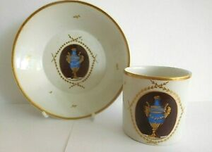 ANTIQUE HOCHST PORCELAIN COFFEE CAN AND SAUCER PAINTED WITH VASES