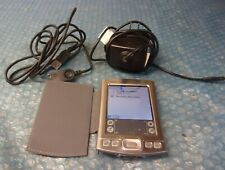 Palm Tungsten E2 Hand Held Organizer has stylus,adapter and charger.