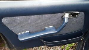 MERCEDES E280 W123 SALOON PASSENGER FRONT DOOR CARD WITH ARMREST BLUE
