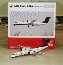 """Herpa Wings Air Canada """"New Color"""" Die-Cast Q400  1/200"""