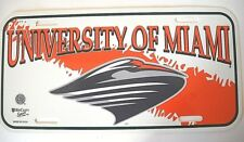 U. OF MIAMI UM HURRICANES PLASTIC ORANGE AND WHITE LICENSE PLATE TAG WITH LOGO