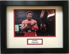 GEORGE FOREMAN HAND SIGNED FRAMED PHOTO BOXING DISPLAY.