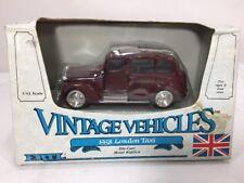 ERTL1958 LONDON TAXI VINTAGE VEHICLES,1:4 Burgundy DIE-CAST 2551