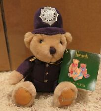 Harrod's Stuffed Bear in police outfit with tag still attached