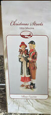 """Christmas Streets 2004 Collection """"Village Figurine"""" Carolers. New in open Box"""