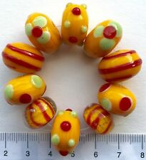 10 x yellow, red, green lampwork , rondelle, glass beads,43 gms    9