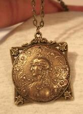 Striking Fleur de Lis Rim Goddess with Peacock Head Dress Brasstone Necklace