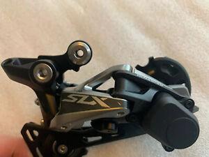 Shimano SLX M7000 Medium Cage Rear Derailleur 11-Speed and trigger