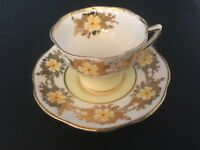 BONE CHINA CUP & SAUCER BY CLARE GOLDEN YELLOW FLOWERS RED DOTS GOLD TRIM