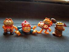 vintage Garfield figurines - paratrooper, football player, wrestler & sports fan