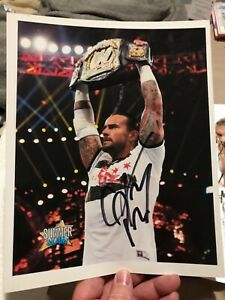 WWE AEW CM PUNK AUTOGRAPH photo with WWE TITLE ABOVE HIS HEAD