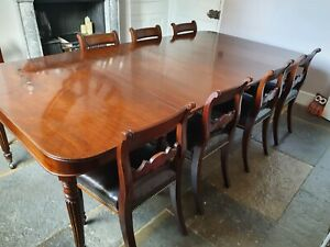 A REGENCY MAHOGANY DINING TABLE AND 8 CHAIRS SEATS 8 - 12 GEORGIAN EXTENDING