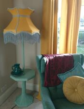 Lampshade in mustard yellow fabric in crown shape with grey trim and lining