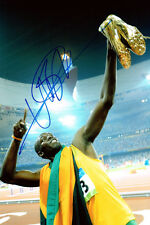 USAIN BOLT 2008 & 2012 Olympic Gold Medal SIGNED 12x8 Photo AFTAL Autograph COA