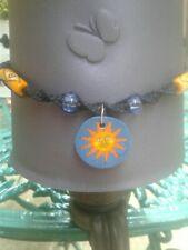 Sun Pendant Black Hemp Necklace Blue Glass Carved Beads