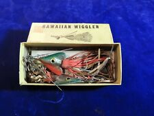 Two Hawaiian wiggler in box with instructions. Fishing lure